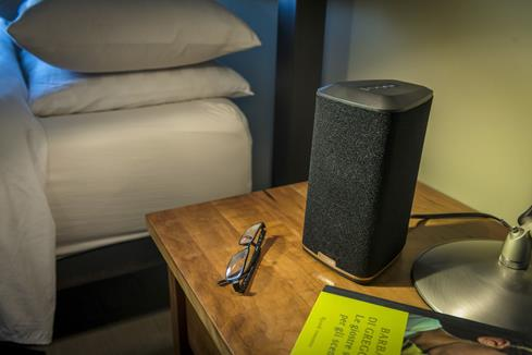 The Klipsch Reference RW-1 on a bedroom table
