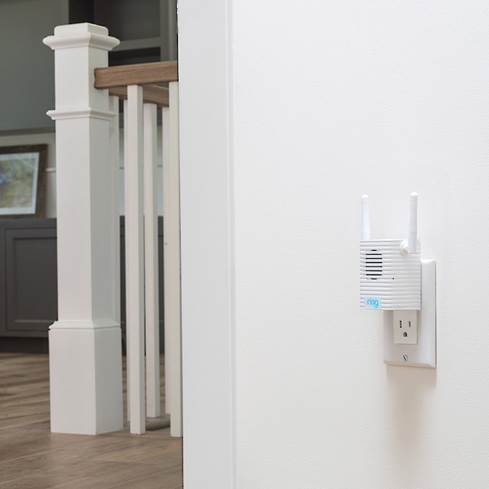 Ring Chime Pro Wi-Fi extender plugged in near staircase.