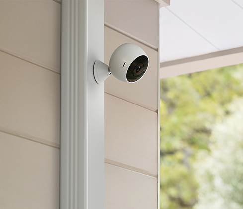 Logitech Circle 2 camera mounted on downspout using magnetic mount accessory.