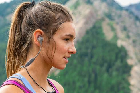 Woman wearing X4  wireless headphones