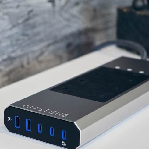 The Austere VII-Series surge protector sports a striking brushed aluminum outer shell and offers six protected, isolated AC outlets.