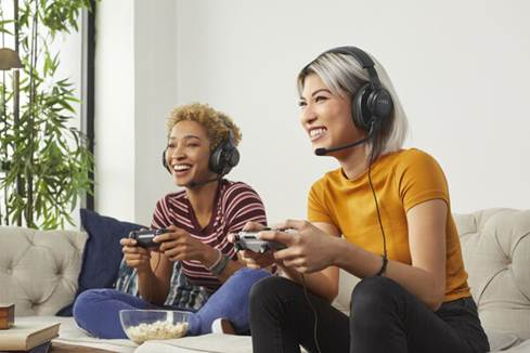 Women playing playstation
