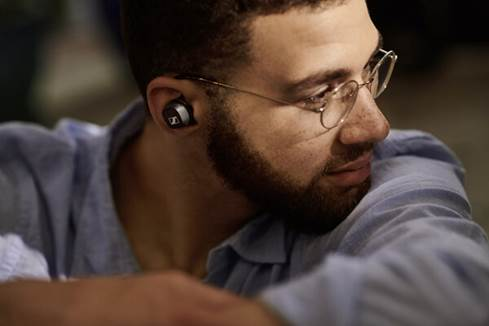 Man wearing Sennheiser CX 400 BT true wireless earbuds