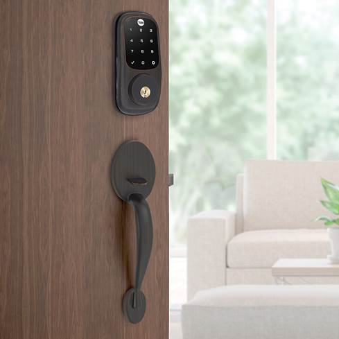 Yale Real Living Assure Lock Touchscreen Deadbolt on exterior entry door