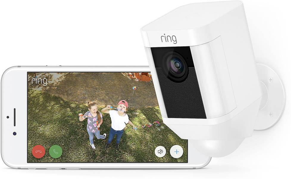 Ring Spotlight Cam and phone with app footage displayed