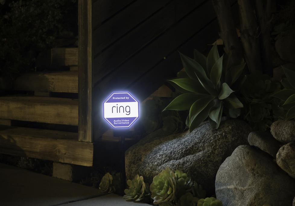 Ring Solar Security Sign illuminated at night.
