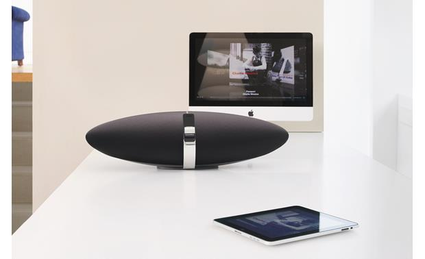 Bowers & Wilkins Zeppelin Air AirPlay illustration: music from iPhone streamed to Zeppelin; video from iPad streamed to Apple TV