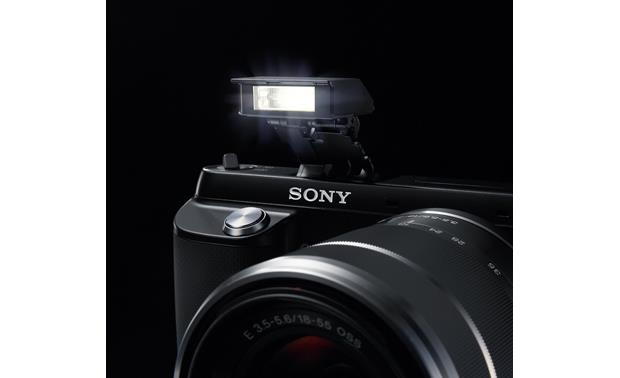 Sony Alpha NEX-F3 Front, 3/4 view, on-board flash deployed
