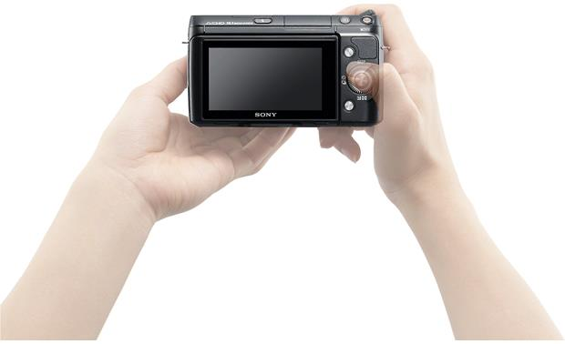 Sony Alpha NEX-F3 Shown in hands for scale