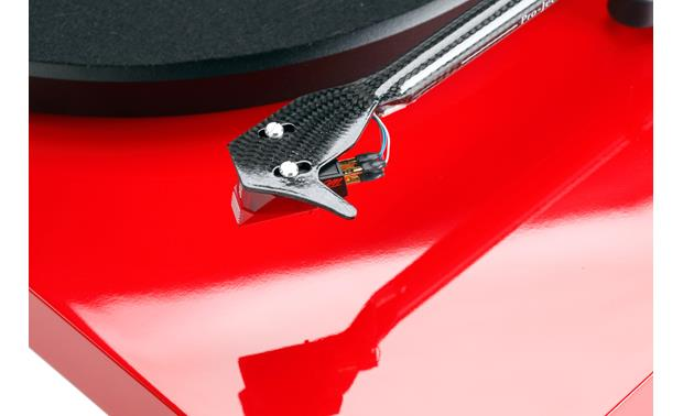 Pro-Ject Debut Carbon Closeup detail of carbon fiber headshell and Ortofon 2M Red cartridge