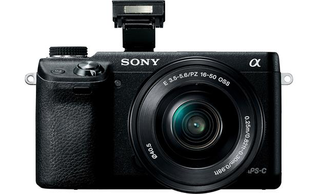 Sony Alpha NEX-6 Front, straight-on, with flash deployed