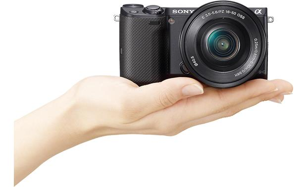 Sony Alpha NEX-5T 3X Zoom Lens Kit Shown in hand for scale