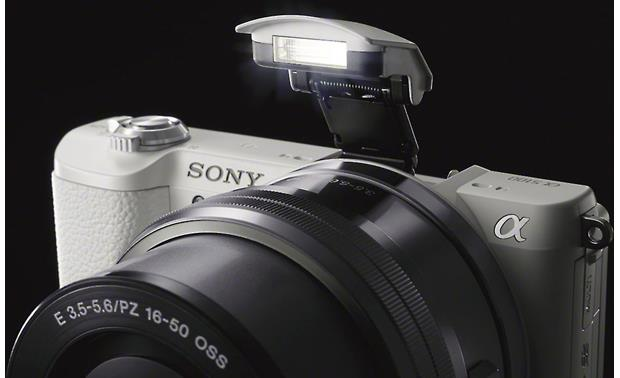 Sony Alpha a5100 Kit Shown with built-in flash deployed
