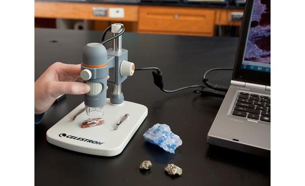 Celestron Handheld Digital Microscope Pro Shown connected to laptop computer using included USB cable (computer not included)