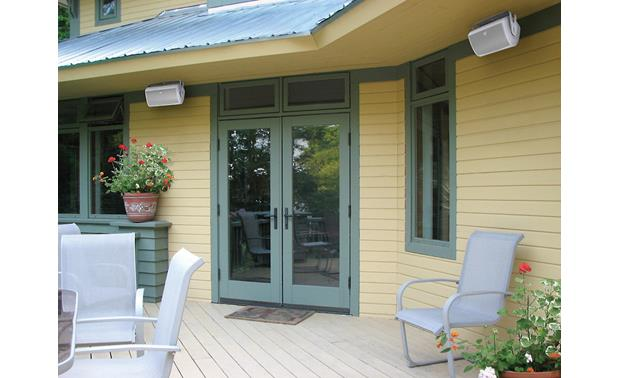 Definitive Technology AW6500 Sold indually; pair shown in white -- installed under eaves