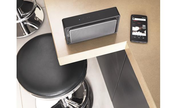 Bowers & Wilkins T7 In kitchen setting, next to phone (not included) for scale