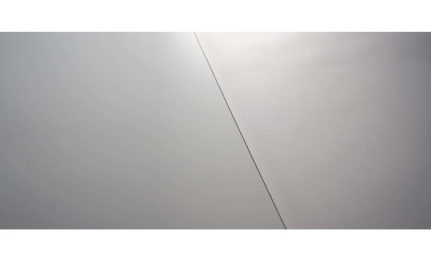 Screen Innovations 5 Series SI's Micro Texture surface (left) is 9X finer and smoother than the typical screen surface