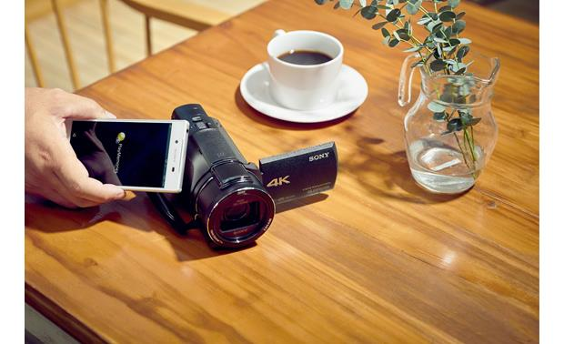 Sony Handycam® FDR-AX53 Quick touch pairing with NFC-enabled devices.