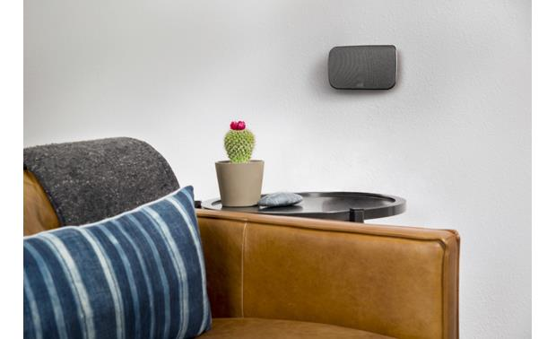 Polk Audio MagniFi MAX SR Wireless surround speakers have keyhole slots for optional wall-mounting