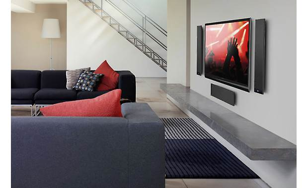 KEF T301C Shown as part of a low-profile home theater system